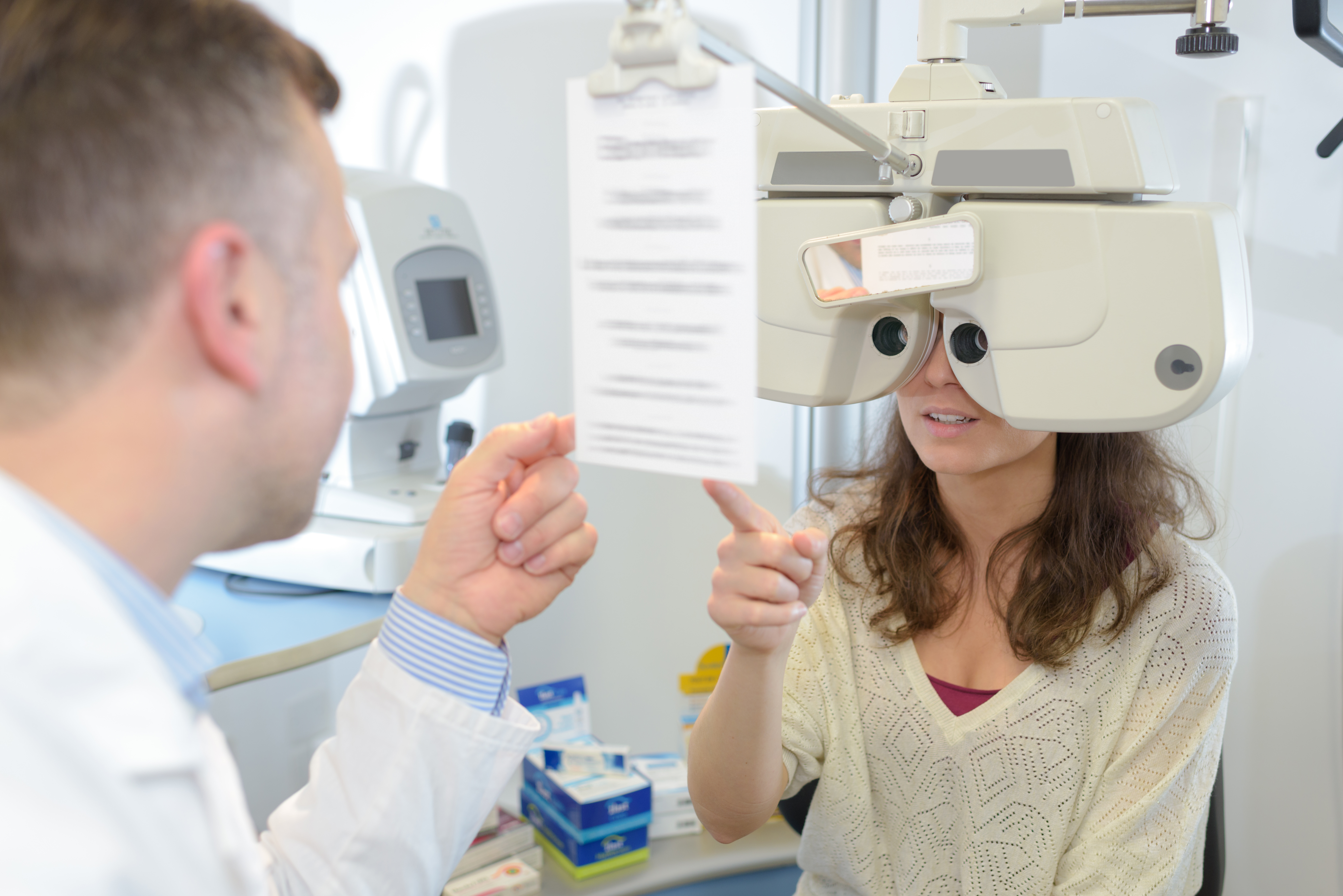 male optometrist examining young patient on PCN8K83 - Blog