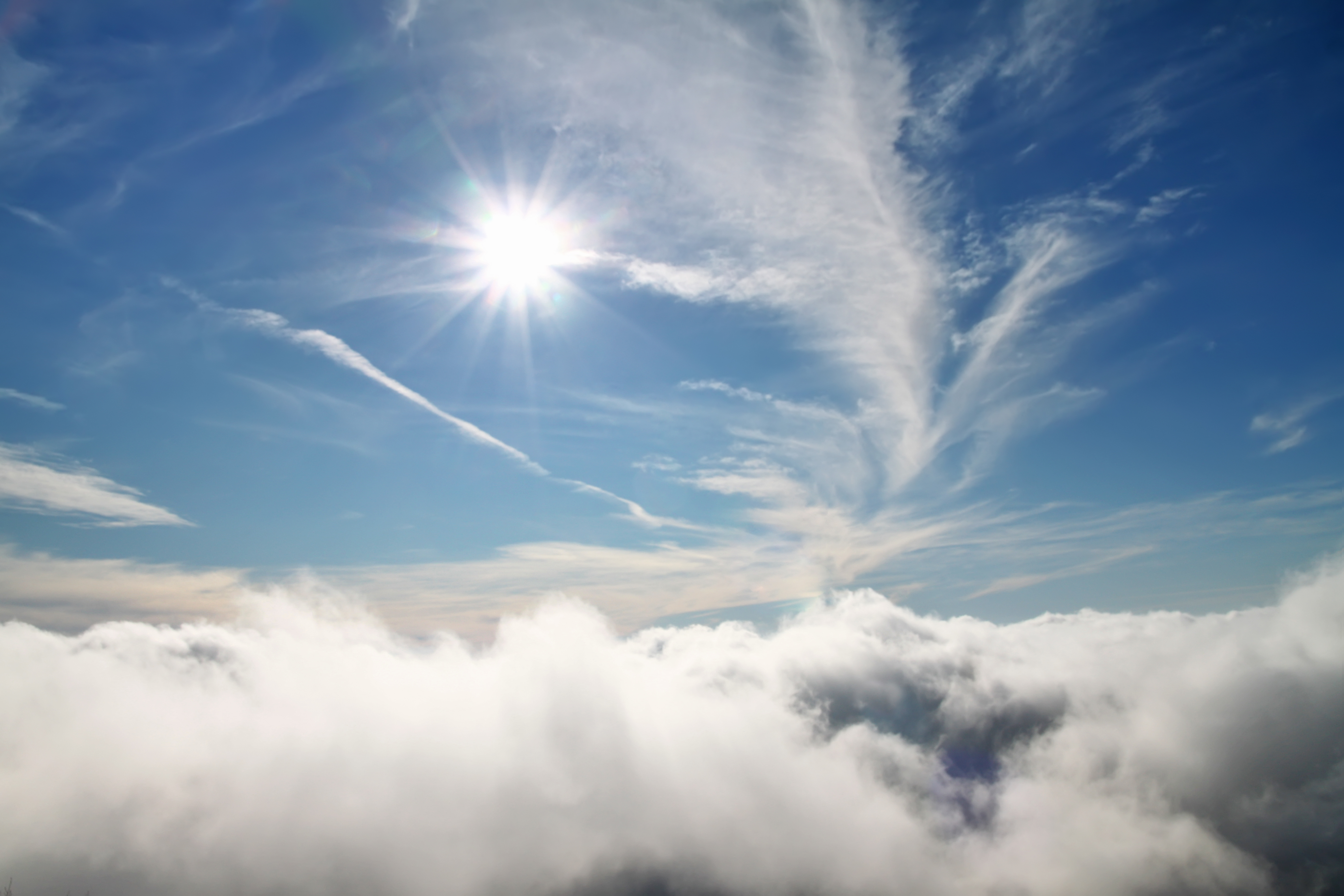blue sky sky with clouds and sun natural E6FNJTL - Is Sunlight Good For Your Eyes? The Science Says No