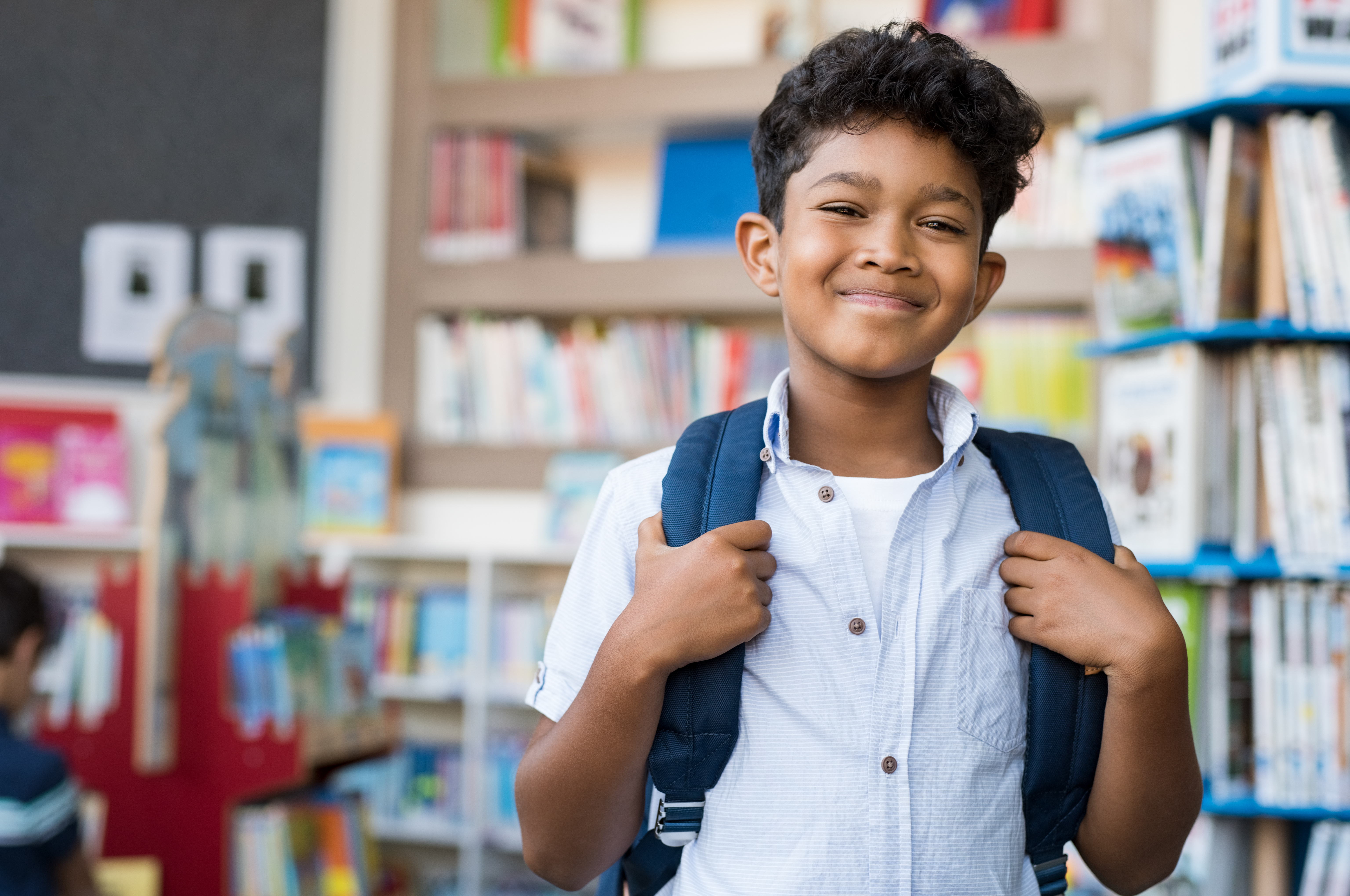 smiling hispanic boy at school PDQS85C - Children May Suffer Long-term Consequences of Technology Use