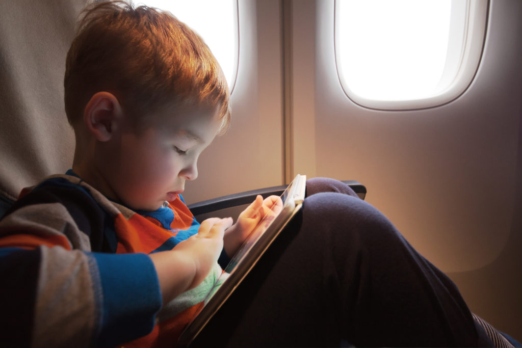 a kid using a tablet and not wearing blue light glasses