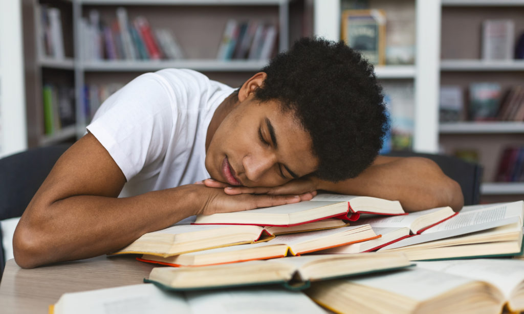 exhausted afro guy sleeping on books in library ZDRE4NS 1024x614 - Exhaustion: A Modern Problem?