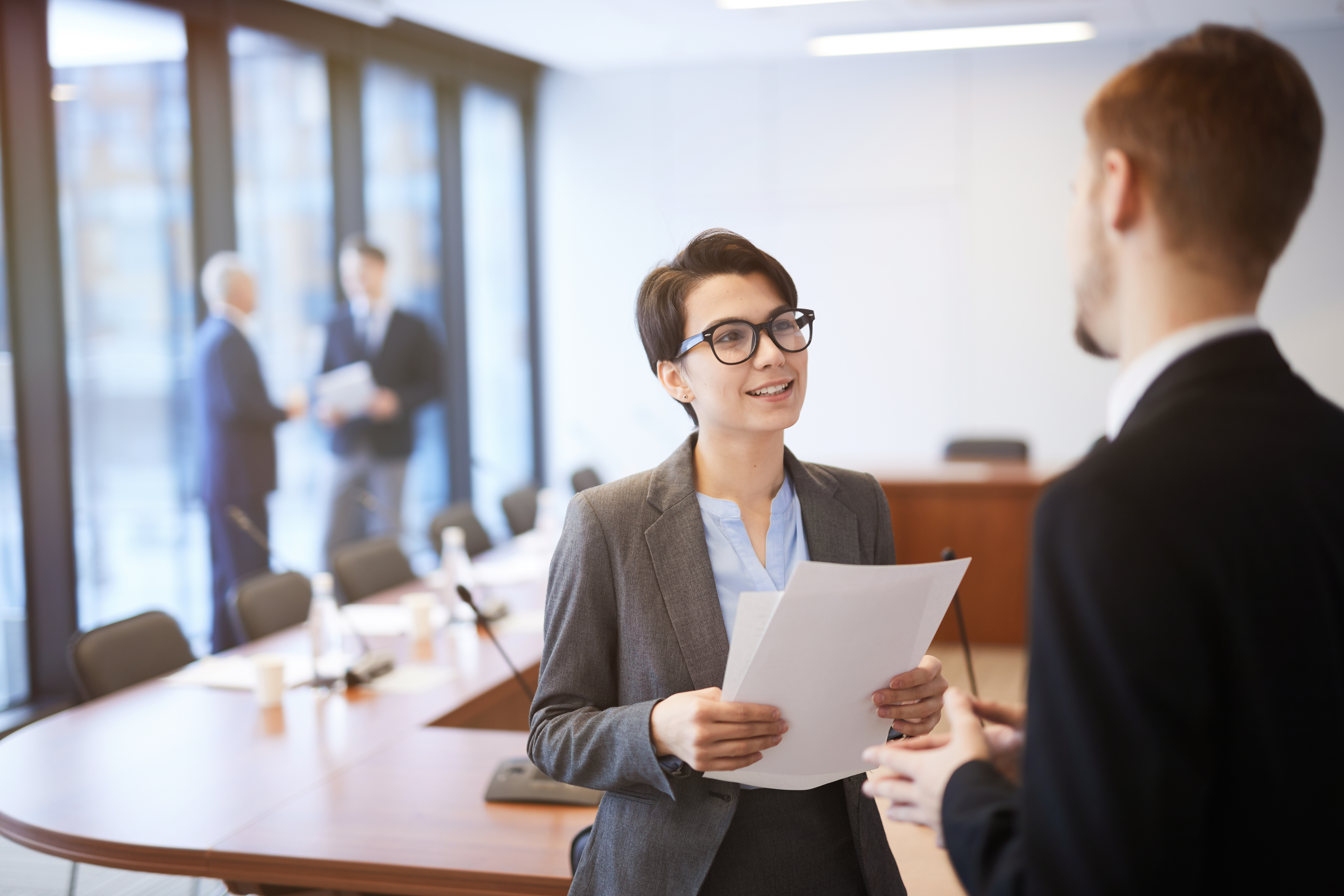 young businesswoman talking to colleague in 5F32P4H - How To Avoid Computer Vision Syndrome
