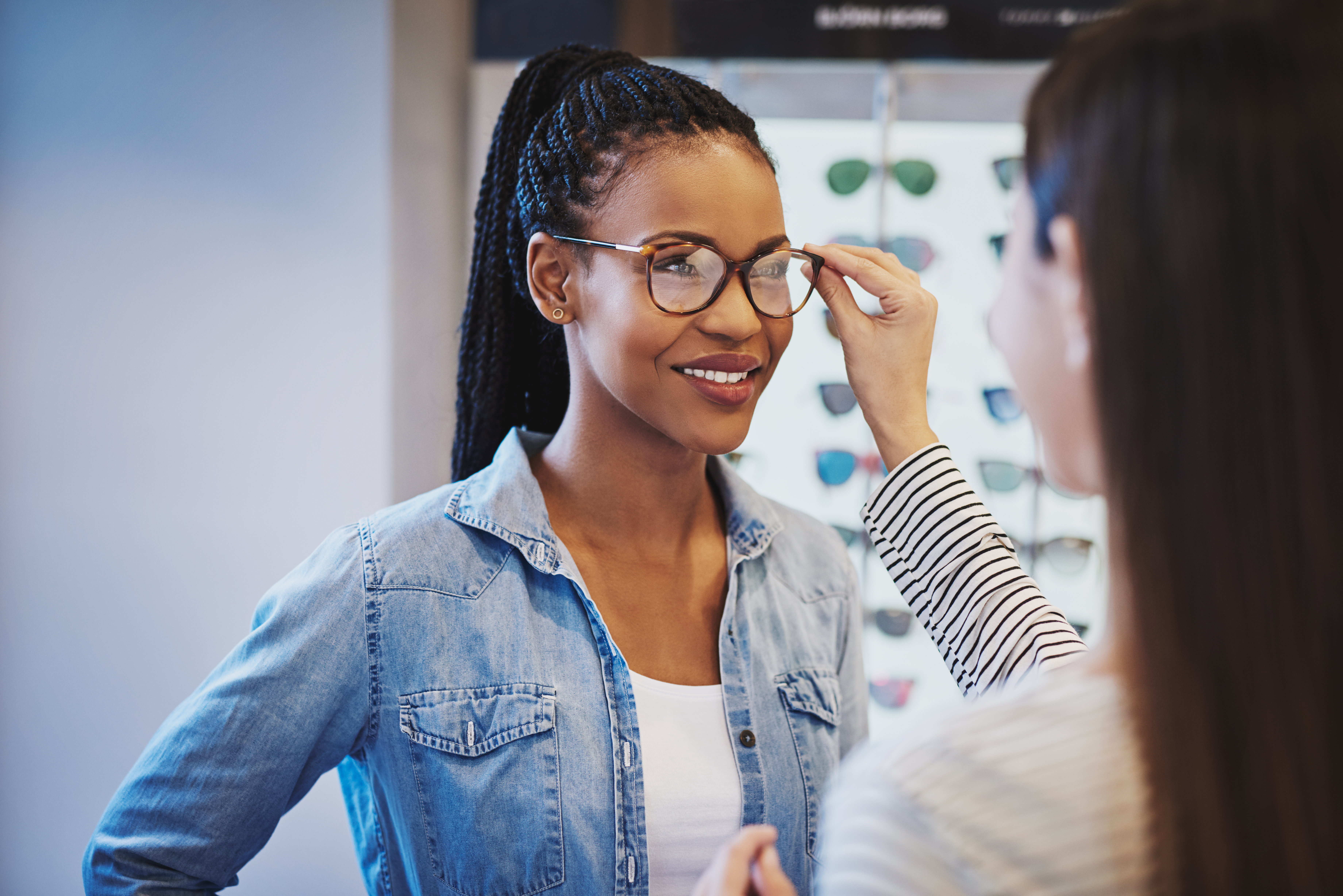 optometrist fitting glasses on a customer PX29ANE - Blog