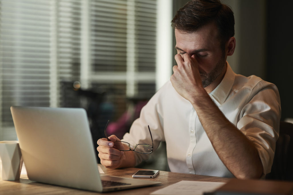 a man experiencing digital eye strain symptoms