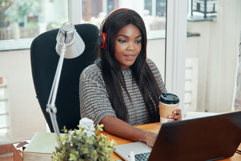 a woman working from home in a noise-cancelling headphones