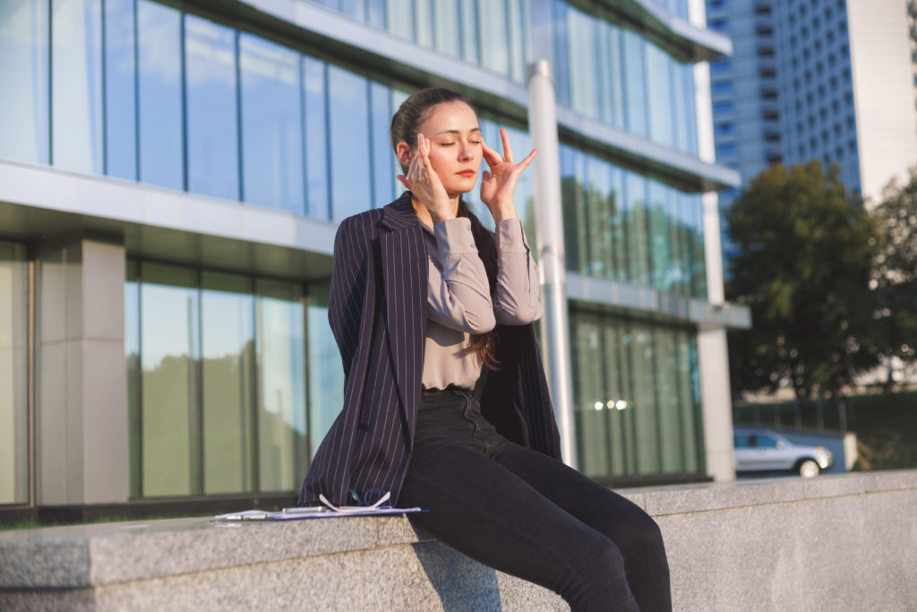 woman experiencing photophobia