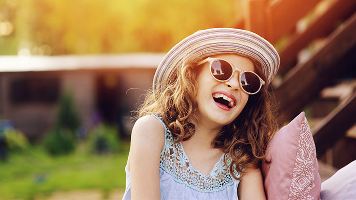 child wearing hat and sunglasses for uv protection