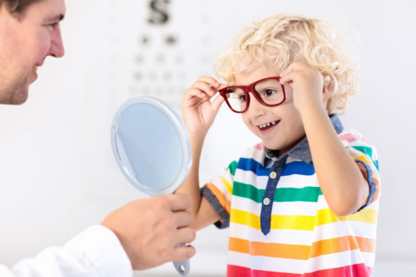 young-boy-trying-on-glasses